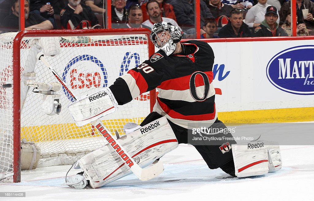 <a gi-track='captionPersonalityLinkClicked' href=/galleries/search?phrase=Ben+Bishop&family=editorial&specificpeople=700137 ng-click='$event.stopPropagation()'>Ben Bishop</a> #30 of the Ottawa Senators makes a blocker save against the Toronto Maple Leafs, during an NHL game at Scotiabank Place, on March 30, 2013 in Ottawa, Ontario, Canada.