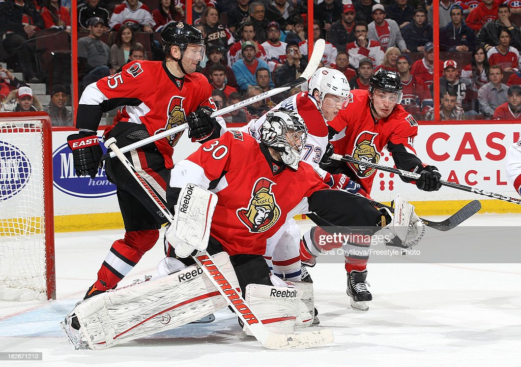 <a gi-track='captionPersonalityLinkClicked' href=/galleries/search?phrase=Ben+Bishop&family=editorial&specificpeople=700137 ng-click='$event.stopPropagation()'>Ben Bishop</a> #30 of the Ottawa Senators makes a glove save as team mates <a gi-track='captionPersonalityLinkClicked' href=/galleries/search?phrase=Sergei+Gonchar&family=editorial&specificpeople=202470 ng-click='$event.stopPropagation()'>Sergei Gonchar</a> #55 and Patrick Wiercioch #46 defend against Brendan Gallagher #73 of the Montreal Canadiens, during an NHL game at Scotiabank Place on February 25, 2013 in Ottawa, Ontario, Canada.
