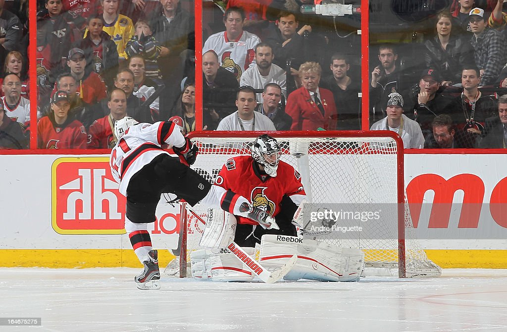 <a gi-track='captionPersonalityLinkClicked' href=/galleries/search?phrase=Ben+Bishop&family=editorial&specificpeople=700137 ng-click='$event.stopPropagation()'>Ben Bishop</a> #30 of the Ottawa Senators makes a glove save on a shoot-out attempt by <a gi-track='captionPersonalityLinkClicked' href=/galleries/search?phrase=Andrei+Loktionov&family=editorial&specificpeople=5370946 ng-click='$event.stopPropagation()'>Andrei Loktionov</a> #21 of the New Jersey Devils on March 25, 2013 at Scotiabank Place in Ottawa, Ontario, Canada.