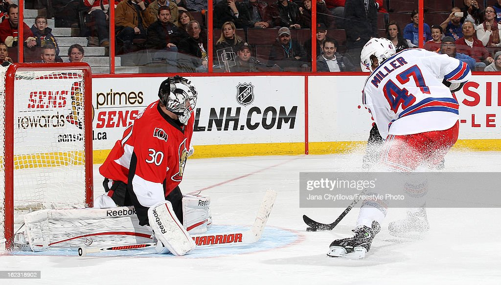 Ben Bishop #30 of the Ottawa Senators makes a save against a shoot-out attempt by J.T. Miller #47 of the New York Rangers during an NHL game at Scotiabank Place on February 21, 2013 in Ottawa, Ontario, Canada.