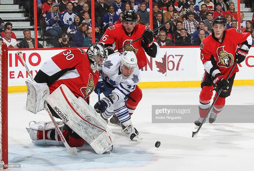 Ben Bishop #30 of the Ottawa Senators makes a save against as Leo Komarov #47 of the Toronto Maple Leafs digs for the rebound in front of Patrick Wiercioch #46 and Kyle Turris #7 on February 23, 2013 at Scotiabank Place in Ottawa, Ontario, Canada.