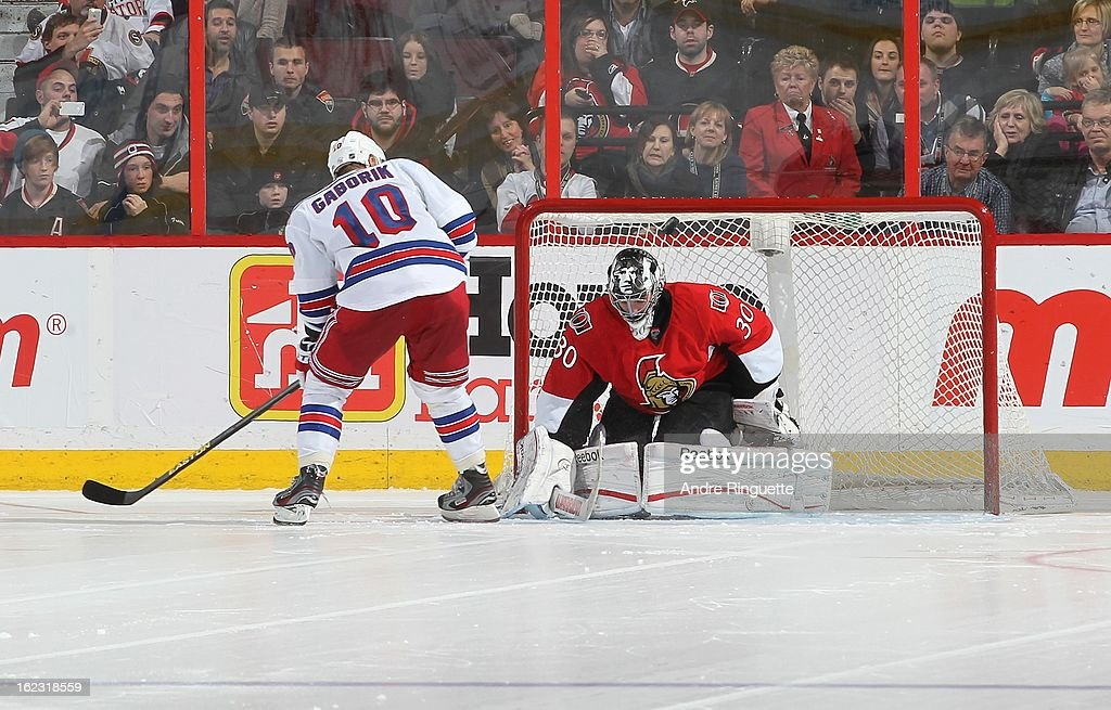 <a gi-track='captionPersonalityLinkClicked' href=/galleries/search?phrase=Ben+Bishop&family=editorial&specificpeople=700137 ng-click='$event.stopPropagation()'>Ben Bishop</a> #30 of the Ottawa Senators makes a save against <a gi-track='captionPersonalityLinkClicked' href=/galleries/search?phrase=Marian+Gaborik&family=editorial&specificpeople=202477 ng-click='$event.stopPropagation()'>Marian Gaborik</a> #10 of the New York Rangers on a shootout attempt on February 21, 2013 at Scotiabank Place in Ottawa, Ontario, Canada.