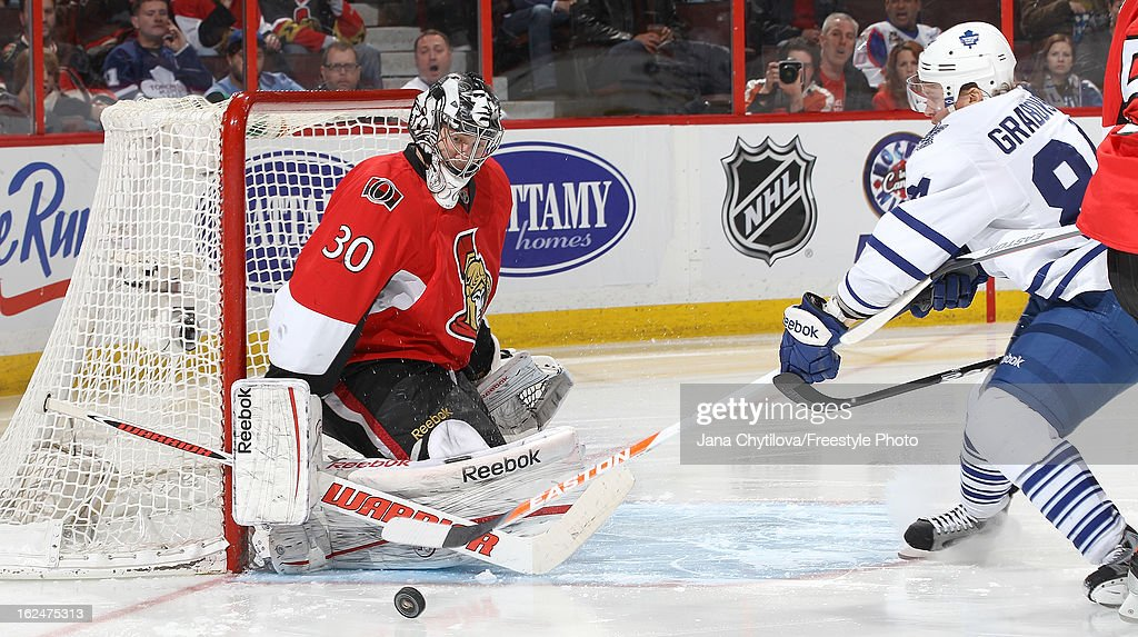 <a gi-track='captionPersonalityLinkClicked' href=/galleries/search?phrase=Ben+Bishop&family=editorial&specificpeople=700137 ng-click='$event.stopPropagation()'>Ben Bishop</a> #30 of the Ottawa Senators makes a save against <a gi-track='captionPersonalityLinkClicked' href=/galleries/search?phrase=Mikhail+Grabovski&family=editorial&specificpeople=2560547 ng-click='$event.stopPropagation()'>Mikhail Grabovski</a> #84 of the Toronto Maple Leafs during an NHL game at Scotiabank Place on February 23, 2013 in Ottawa, Ontario, Canada.