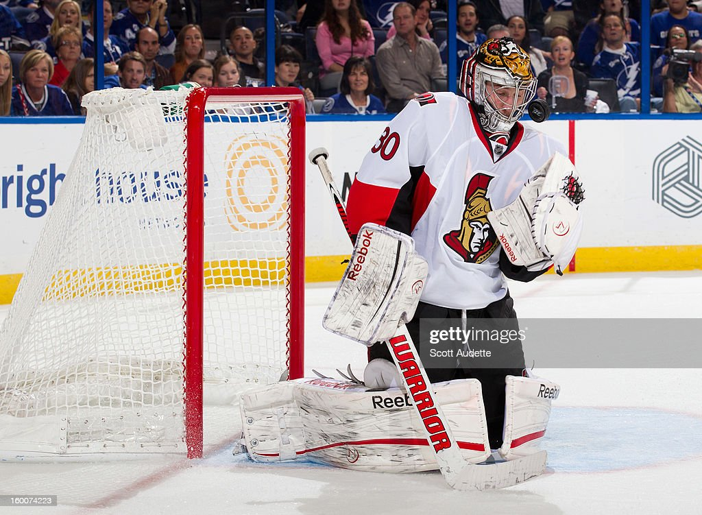 <a gi-track='captionPersonalityLinkClicked' href=/galleries/search?phrase=Ben+Bishop&family=editorial&specificpeople=700137 ng-click='$event.stopPropagation()'>Ben Bishop</a> #30 of the Ottawa Senators makes a save against the Tampa Bay Lightning at the Tampa Bay Times Forum on January 25, 2013 in Tampa, Florida.