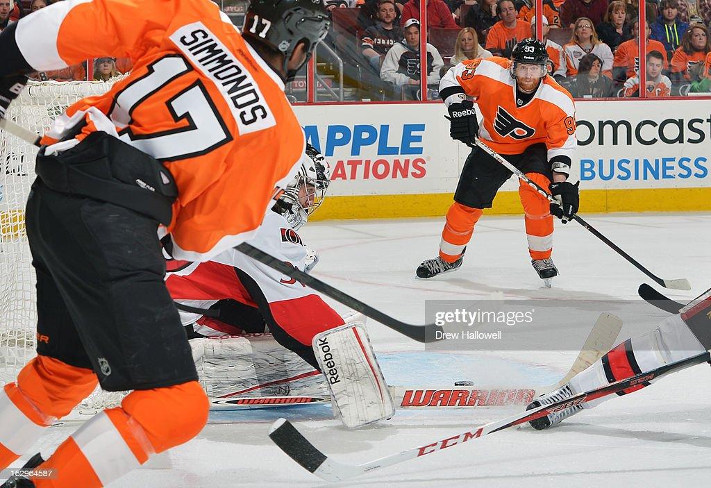 Ben Bishop #30 of the Ottawa Senators makes a save in front of Wayne Simmonds #17 and Jakub Voracek #93 of the Philadelphia Flyers at the Wells Fargo Center on March 2, 2013 in Philadelphia, Pennsylvania.