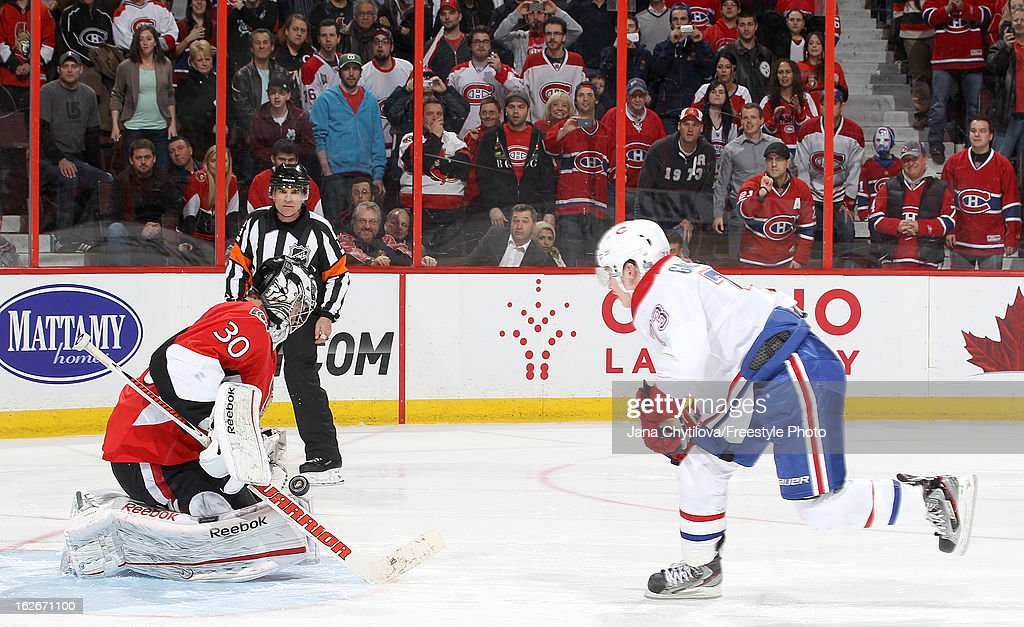 <a gi-track='captionPersonalityLinkClicked' href=/galleries/search?phrase=Ben+Bishop&family=editorial&specificpeople=700137 ng-click='$event.stopPropagation()'>Ben Bishop</a> #30 of the Ottawa Senators makes a shootout save against Brendan Gallagher #73 of the Montreal Canadiens, during an NHL game at Scotiabank Place on February 25, 2013 in Ottawa, Ontario, Canada.