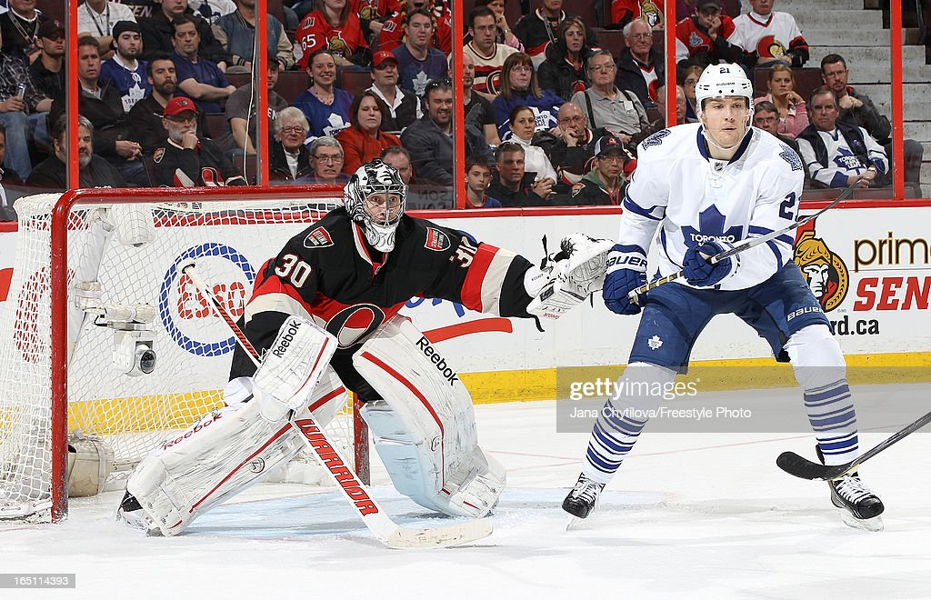 <a gi-track='captionPersonalityLinkClicked' href=/galleries/search?phrase=Ben+Bishop&family=editorial&specificpeople=700137 ng-click='$event.stopPropagation()'>Ben Bishop</a> #30 of the Ottawa Senators pushes James van Riemsdyk #21 of the Toronto Maple Leafs as he defends the net, during an NHL game at Scotiabank Place, on March 30, 2013 in Ottawa, Ontario, Canada.