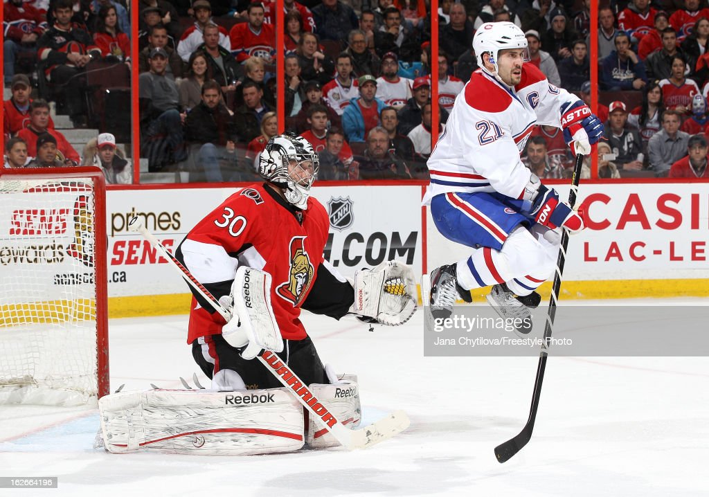 Ben Bishop #30 of the Ottawa Senators watches the play as Brian Gionta #21 of the Montreal Canadiens jumps up to provide a screen, during an NHL game at Scotiabank Place on February 25, 2013 in Ottawa, Ontario, Canada.