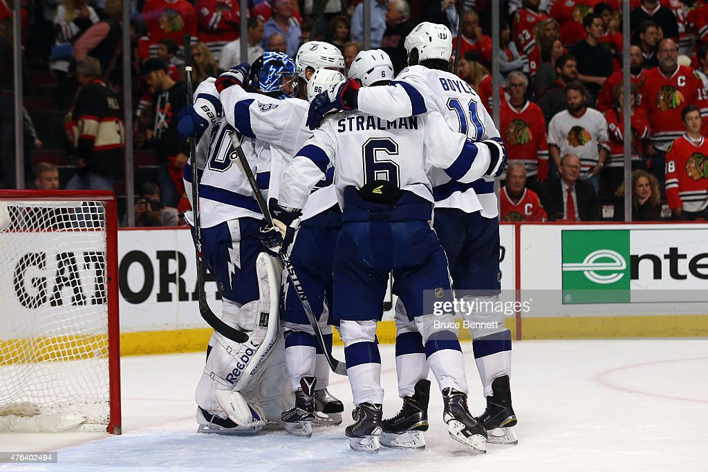 Ben Bishop #30 of the Tampa Bay Lightning celebrates with his teammates after defeating the Chicago Blackhawks 3-2 in Game Three of the 2015 NHL Stanley Cup Final at the United Center on June 8, 2015 in Chicago, Illinois.