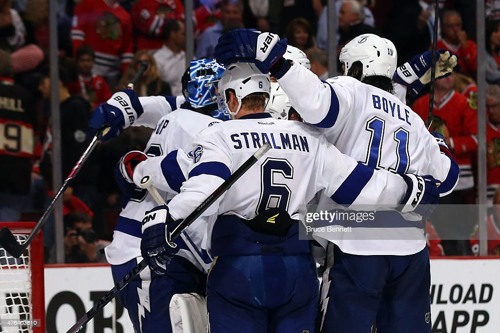 <a gi-track='captionPersonalityLinkClicked' href=/galleries/search?phrase=Ben+Bishop&family=editorial&specificpeople=700137 ng-click='$event.stopPropagation()'>Ben Bishop</a> #30 of the Tampa Bay Lightning celebrates with his teammates after defeating the Chicago Blackhawks 3-2 in Game Three of the 2015 NHL Stanley Cup Final at the United Center on June 8, 2015 in Chicago, Illinois.