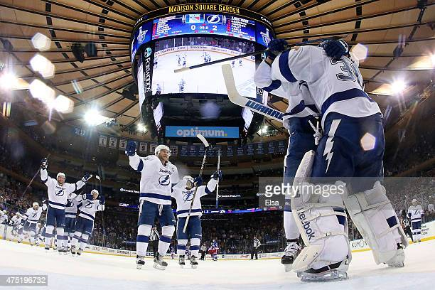 Ben Bishop of the Tampa Bay Lightning celebrates with teammate Nikita Kucherov after defeating the New York Rangers by a score of 20 to win Game...