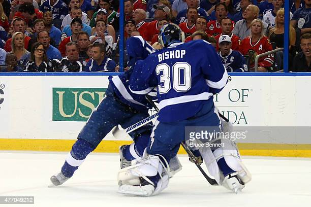 Ben Bishop of the Tampa Bay Lightning collides with Victor Hedman in the first period against the Chicago Blackhawks Game Five of the 2015 NHL...