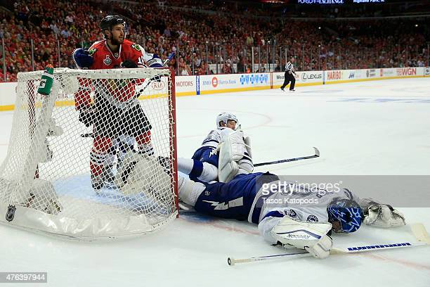 Ben Bishop of the Tampa Bay Lightning lays on the ice after a play against the Chicago Blackhawks during Game Three of the 2015 NHL Stanley Cup Final...