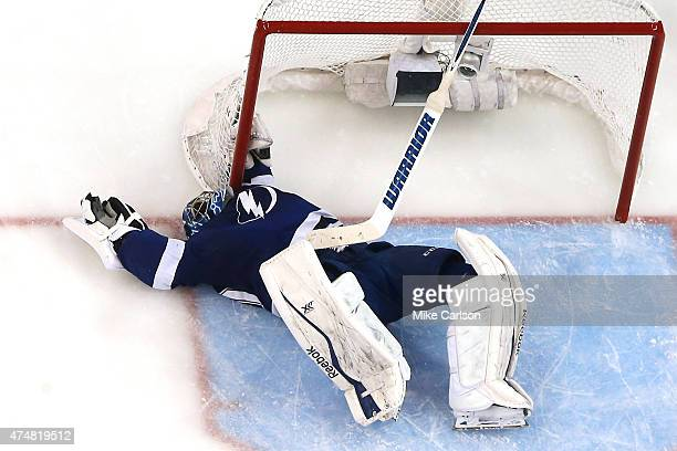 Ben Bishop of the Tampa Bay Lightning lays on the ice after making a save against the New York Rangers in Game Six of the Eastern Conference Finals...