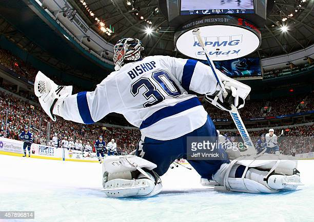 Ben Bishop of the Tampa Bay Lightning makes a glove save during their NHL game against theVancouver Canucks at Rogers Arena October 18 2014 in...