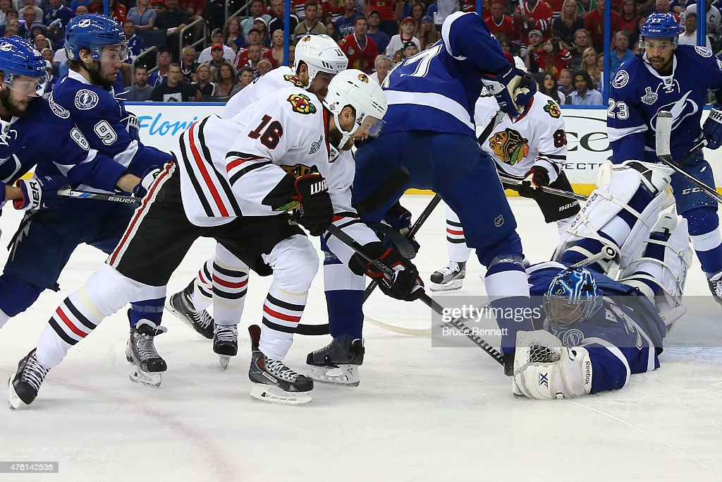 <a gi-track='captionPersonalityLinkClicked' href=/galleries/search?phrase=Ben+Bishop&family=editorial&specificpeople=700137 ng-click='$event.stopPropagation()'>Ben Bishop</a> #30 of the Tampa Bay Lightning makes a save against Marcus Kruger #16 of the Chicago Blackhawks during the first period in Game Two of the 2015 NHL Stanley Cup Final at Amalie Arena on June 6, 2015 in Tampa, Florida.