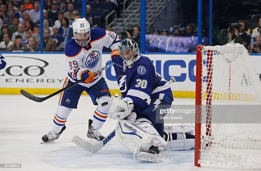 <a gi-track='captionPersonalityLinkClicked' href=/galleries/search?phrase=Ben+Bishop&family=editorial&specificpeople=700137 ng-click='$event.stopPropagation()'>Ben Bishop</a> #30 of the Tampa Bay Lightning makes a save against <a gi-track='captionPersonalityLinkClicked' href=/galleries/search?phrase=Sam+Gagner&family=editorial&specificpeople=4042961 ng-click='$event.stopPropagation()'>Sam Gagner</a> #89 of the Edmonton Oilers during the third period at Tampa Bay Times Forum on November 7, 2013 in Tampa, Florida.