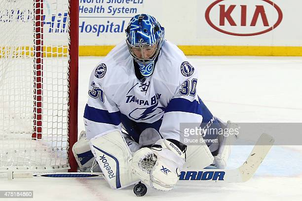 Ben Bishop of the Tampa Bay Lightning makes a save against the New York Rangers during the second period in Game Seven of the Eastern Conference...