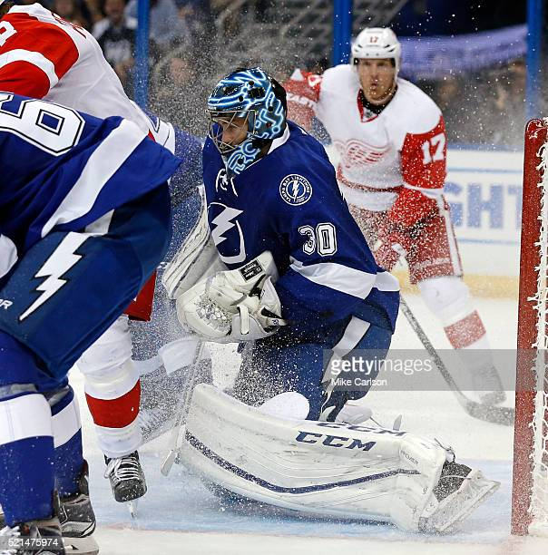 Ben Bishop of the Tampa Bay Lightning makes a save against the Detroit Red Wings during the third period in Game Two of the Eastern Conference...