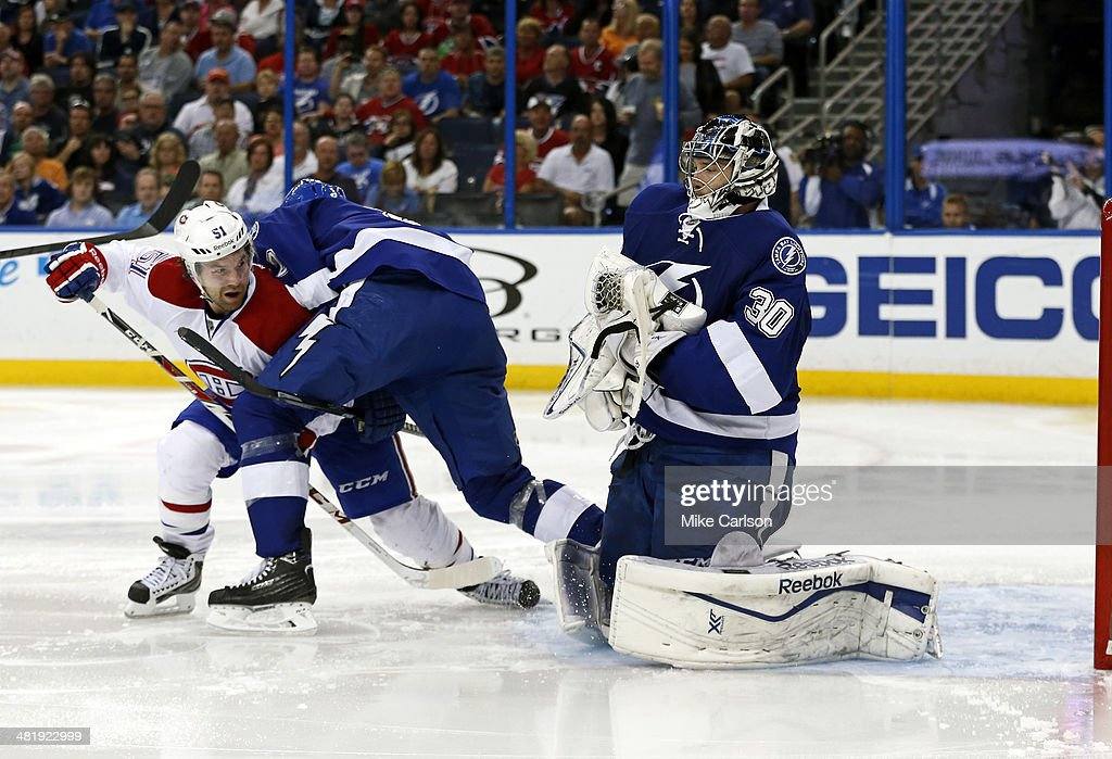 <a gi-track='captionPersonalityLinkClicked' href=/galleries/search?phrase=Ben+Bishop&family=editorial&specificpeople=700137 ng-click='$event.stopPropagation()'>Ben Bishop</a> #30 of the Tampa Bay Lightning makes a save as teammate <a gi-track='captionPersonalityLinkClicked' href=/galleries/search?phrase=Eric+Brewer&family=editorial&specificpeople=202144 ng-click='$event.stopPropagation()'>Eric Brewer</a> #2 blocks <a gi-track='captionPersonalityLinkClicked' href=/galleries/search?phrase=David+Desharnais&family=editorial&specificpeople=4084305 ng-click='$event.stopPropagation()'>David Desharnais</a> #51 of the Montreal Canadiens at the Tampa Bay Times Forum on April 1, 2014 in Tampa, Florida.