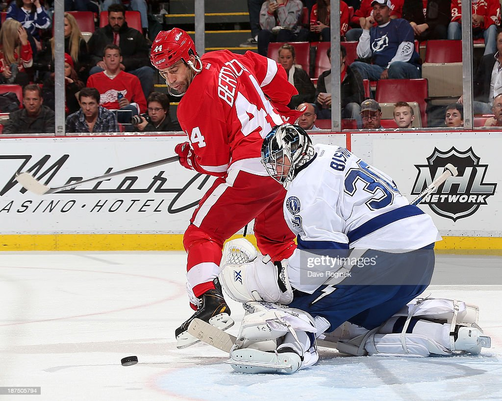 <a gi-track='captionPersonalityLinkClicked' href=/galleries/search?phrase=Ben+Bishop&family=editorial&specificpeople=700137 ng-click='$event.stopPropagation()'>Ben Bishop</a> #30 of the Tampa Bay Lightning makes a save as <a gi-track='captionPersonalityLinkClicked' href=/galleries/search?phrase=Todd+Bertuzzi&family=editorial&specificpeople=202476 ng-click='$event.stopPropagation()'>Todd Bertuzzi</a> #44 of the Detroit Red Wings screens him during an NHL game at Joe Louis Arena on November 9, 2013 in Detroit, Michigan.