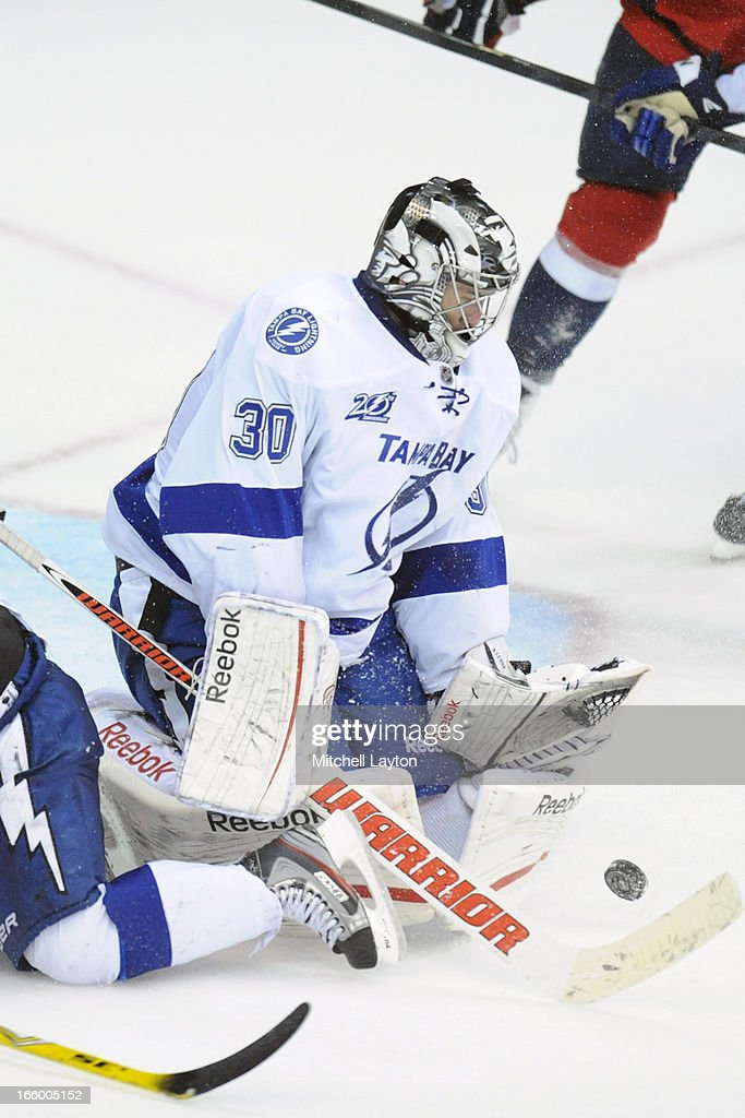 <a gi-track='captionPersonalityLinkClicked' href=/galleries/search?phrase=Ben+Bishop&family=editorial&specificpeople=700137 ng-click='$event.stopPropagation()'>Ben Bishop</a> #30 of the Tampa Bay Lightning makes a save during a NHL hockey game against the Washington Capitals on April 7, 2013 at the Verizon Center in Washington, DC. The Capital won 4-2.