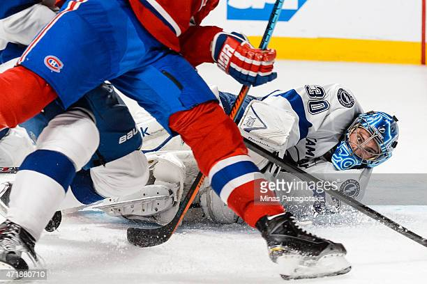 Ben Bishop of the Tampa Bay Lightning makes a save during the first overtime period in Game One of the Eastern Conference Semifinals against the...