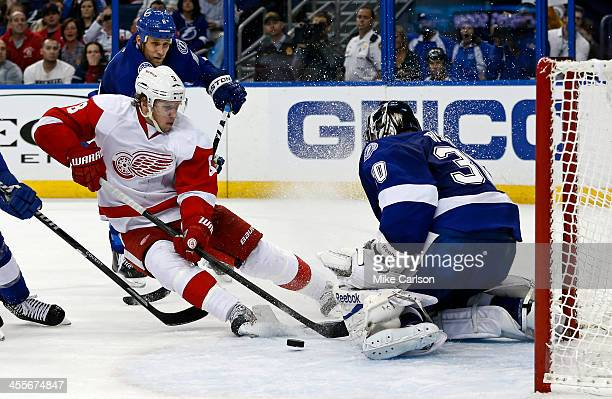 Ben Bishop of the Tampa Bay Lightning makes a save on Justin Abdelkader of the Detroit Red Wings as he's defended by Sami Salo at the Tampa Bay Times...
