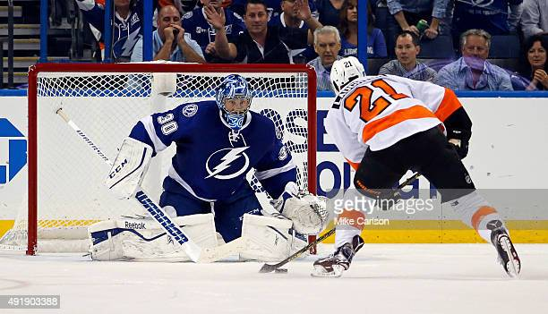 Ben Bishop of the Tampa Bay Lightning prepares to make a save on a penalty shot by Scott Laughton of the Philadelphia Flyers in overtime at the...