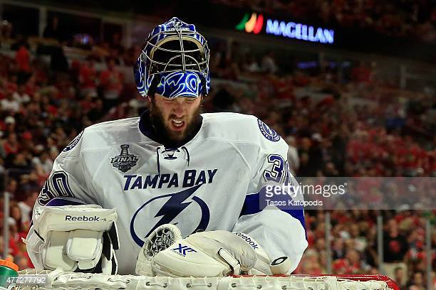 Ben Bishop of the Tampa Bay Lightning reacts after a play at the net against the Chicago Blackhawks during the second period in Game Six of the 2015...