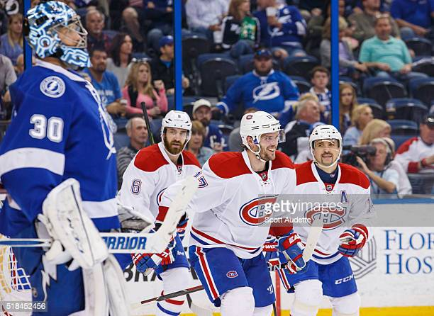 Ben Bishop of the Tampa Bay Lightning reacts to a goal for Torrey Mitchell and the Montreal Canadiens during the second period at the Amalie Arena on...