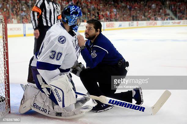 Ben Bishop of the Tampa Bay Lightning receives medical attention in the second period against the Chicago Blackhawks during Game Three of the 2015...