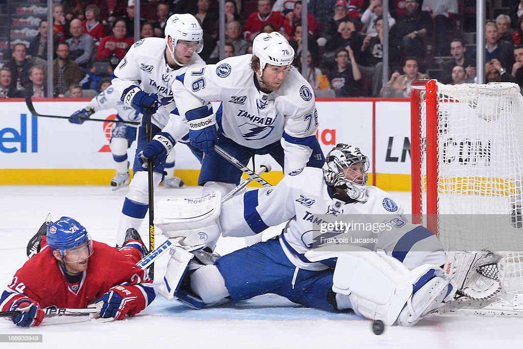 <a gi-track='captionPersonalityLinkClicked' href=/galleries/search?phrase=Ben+Bishop&family=editorial&specificpeople=700137 ng-click='$event.stopPropagation()'>Ben Bishop</a> #30 of the Tampa Bay Lightning stops a shot in NHL action against the Montreal Canadiens on April 18, 2013 at the Bell Centre in Montreal, Quebec, Canada.