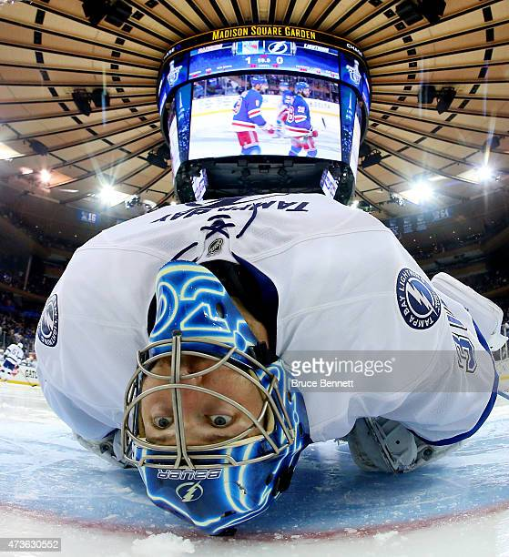 Ben Bishop of the Tampa Bay Lightning stretches before the start of the third period against the New York Rangers in Game One of the Eastern...