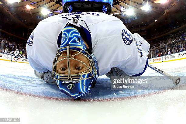 Ben Bishop of the Tampa Bay Lightning stretches before the start of the first period prior to Game Two of the Eastern Conference Finals against the...