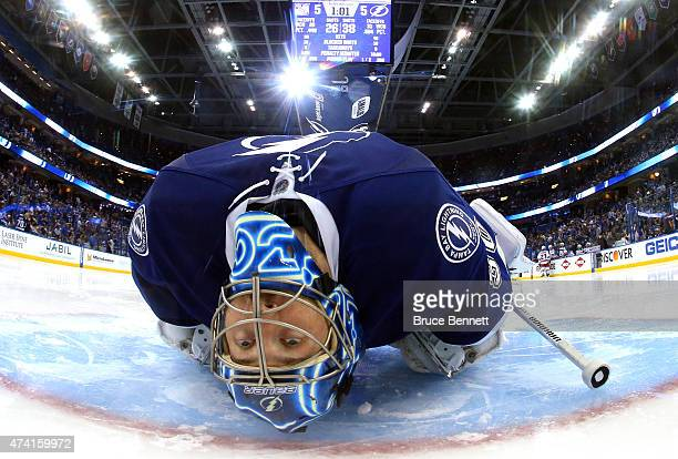 Ben Bishop of the Tampa Bay Lightning stretches before the start of overtime in Game Three of the Eastern Conference Finals against the New York...