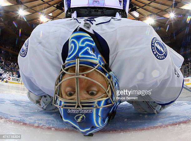 Ben Bishop of the Tampa Bay Lightning stretches prior to the start of the third period in Game Five of the Eastern Conference Finals against the New...