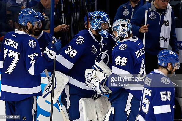 Ben Bishop of the Tampa Bay Lightning switches with Andrei Vasilevskiy during a break in play in the third period against the Chicago Blackhawks...