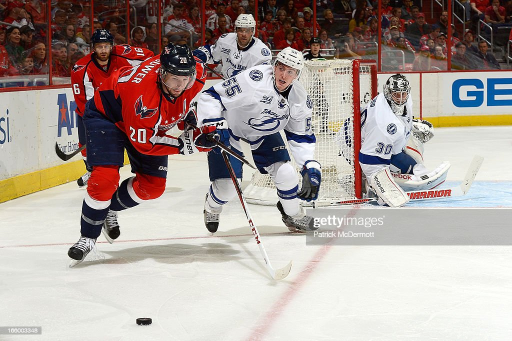 <a gi-track='captionPersonalityLinkClicked' href=/galleries/search?phrase=Ben+Bishop&family=editorial&specificpeople=700137 ng-click='$event.stopPropagation()'>Ben Bishop</a> #30 of the Tampa Bay Lightning watches Matt Taormina #55 battle for the puck against <a gi-track='captionPersonalityLinkClicked' href=/galleries/search?phrase=Troy+Brouwer&family=editorial&specificpeople=4155305 ng-click='$event.stopPropagation()'>Troy Brouwer</a> #20 of the Washington Capitals during an NHL game at Verizon Center on April 7, 2013 in Washington, DC.