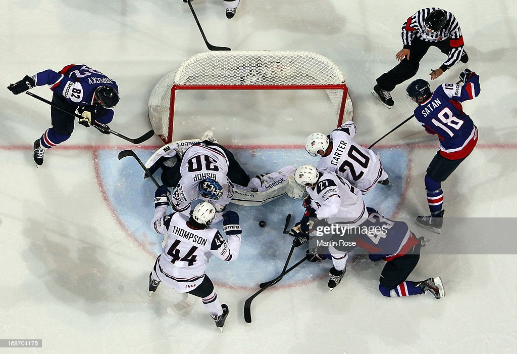 <a gi-track='captionPersonalityLinkClicked' href=/galleries/search?phrase=Ben+Bishop&family=editorial&specificpeople=700137 ng-click='$event.stopPropagation()'>Ben Bishop</a> (C) of USA makes a save during the IIHF World Championship group H match between Slovakia and USA at Hartwall Areena on May 14, 2013 in Helsinki, Finland.