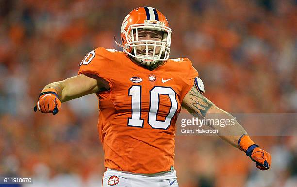 Ben Boulware of the Clemson Tigers reacts after sacking Lamar Jackson of the Louisville Cardinals during the second quarter at Memorial Stadium on...