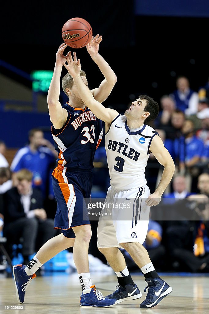 Ben Brackney #33 of the Bucknell Bison passes against Alex Barlow #3 of the Butler Bulldogs in the first half during the second round of the 2013 NCAA Men's Basketball Tournament at the Rupp Arena on March 21, 2013 in Lexington, Kentucky.