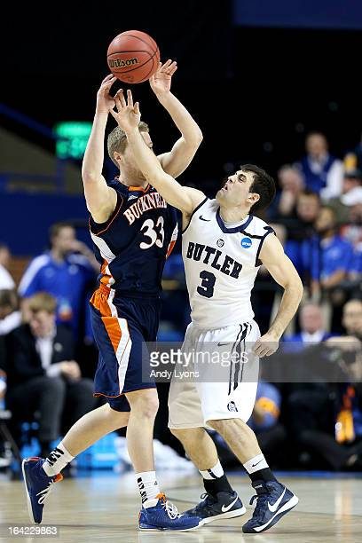 Ben Brackney of the Bucknell Bison passes against Alex Barlow of the Butler Bulldogs in the first half during the second round of the 2013 NCAA Men's...