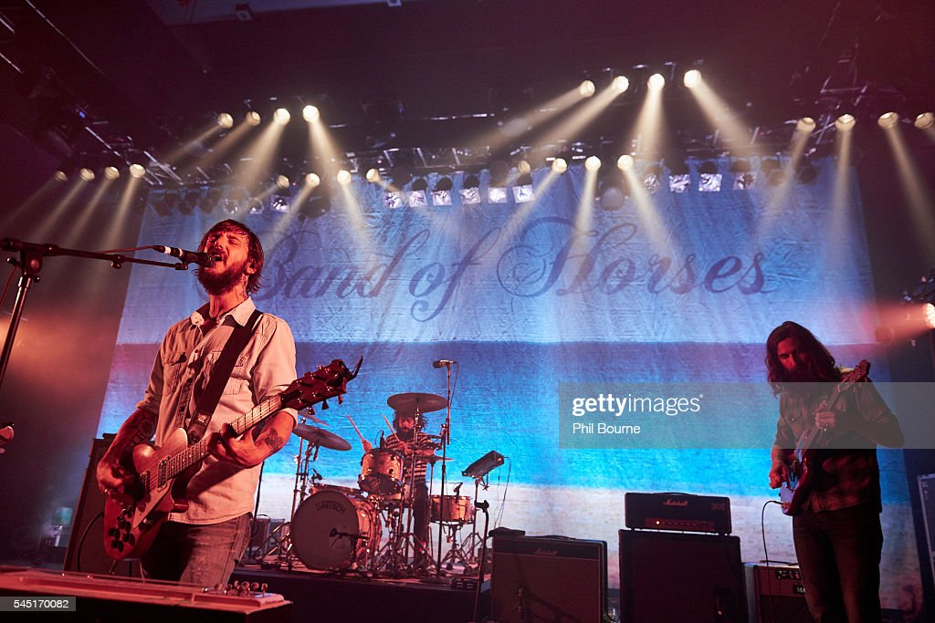 Ben Bridwell Creighton Barrett and Tyler Ramsey of Band of Horses performing at O2 Shepherd's Bush Empire on July 5 2016 in London England