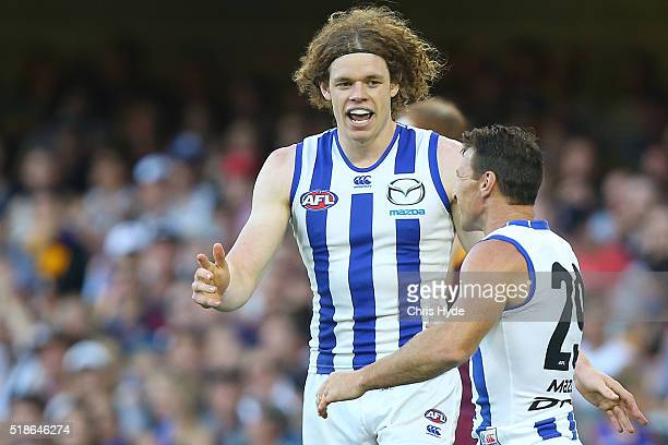 Ben Brown and Brent Harvey of the Kangaroos celebrate a goal during the round two AFL match between the Brisbane Lions and the North Melbourne...