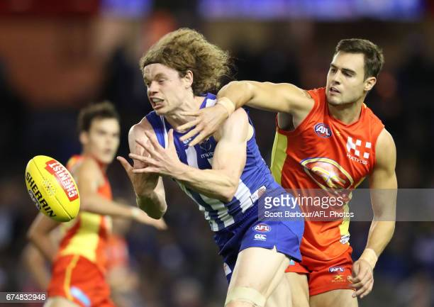 Ben Brown of the Kangaroos and Jack Leslie of the Suns compete for the ball during the round six AFL match between the North Melbourne Kangaroos and...