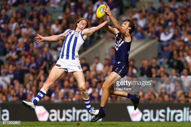 Ben Brown of the Kangaroos and Joel Hamling of the Dockers contest a mark during the round five AFL match between the Fremantle Dockers and the North...