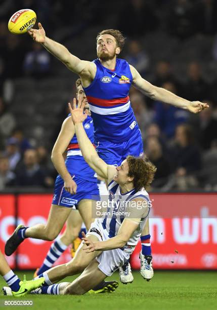 Ben Brown of the Kangaroos and Jordan Roughead of the Bulldogs during the round 14 AFL match between the Western Bulldogs and the North Melbourne...