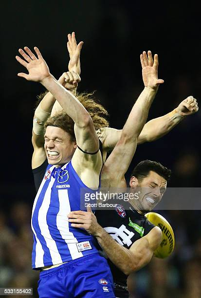 Ben Brown of the Kangaroos and Simon White of the Blues compete for the ball during the round nine AFL match between the North Melbourne Kangaroos...