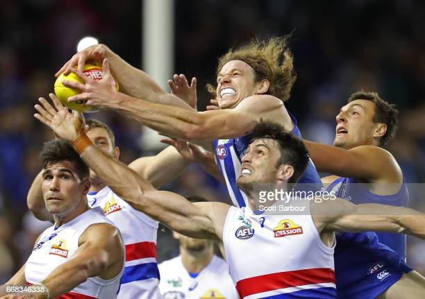 Ben Brown of the Kangaroos attempts to take a marks the ball ahead of Tom Campbell of the Bulldogs during the round four AFL match between the North...